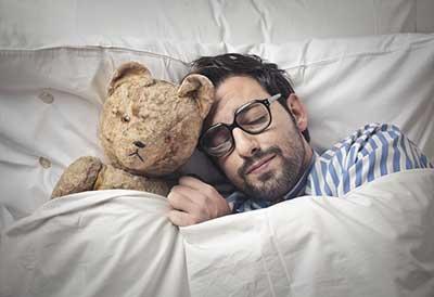 Man Sleeping With Teddy Bear