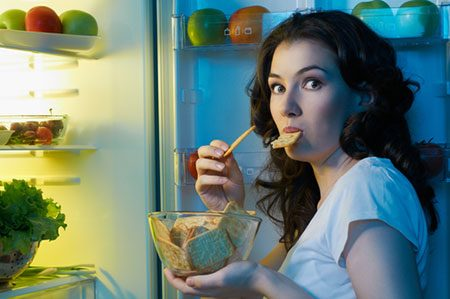 Woman Snacking At Night Because She Didn't Have Her Green Tea