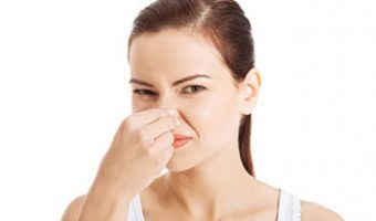 Woman Holding Nose Because Duvet Needs Washed