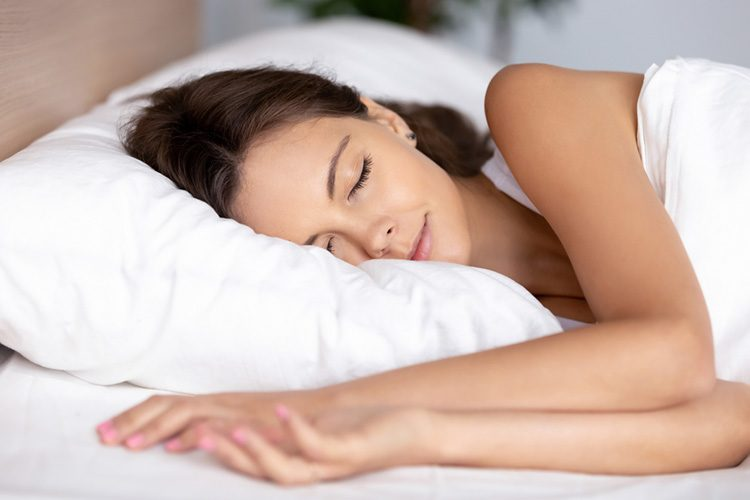 Woman asleep On Memory Foam Pillow