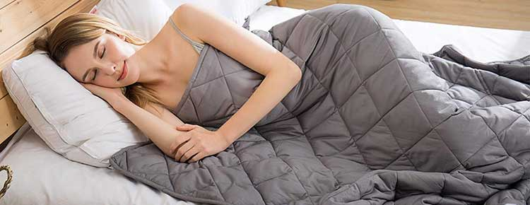 Woman sleeping under weighted blanket