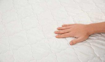 Man CHecking mattress firmness